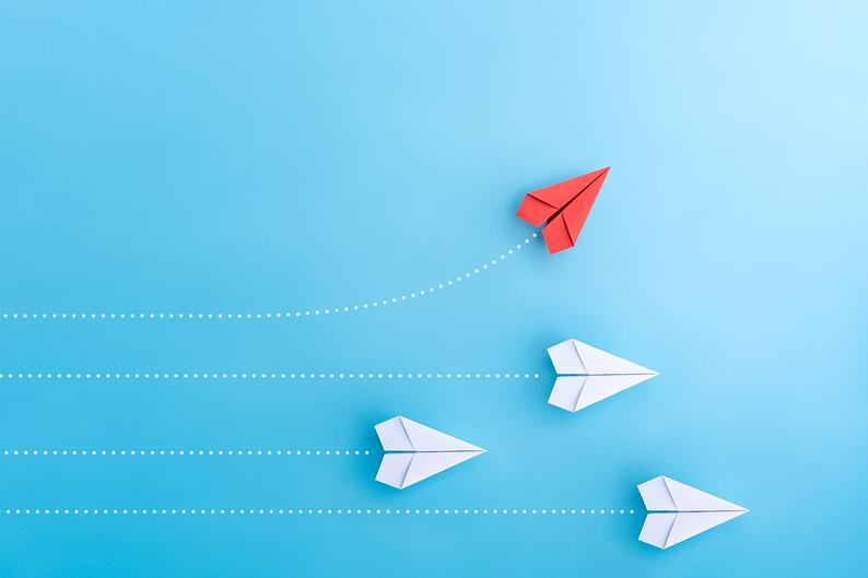 paper planes on blue background, as a concept of how to spot opportunities