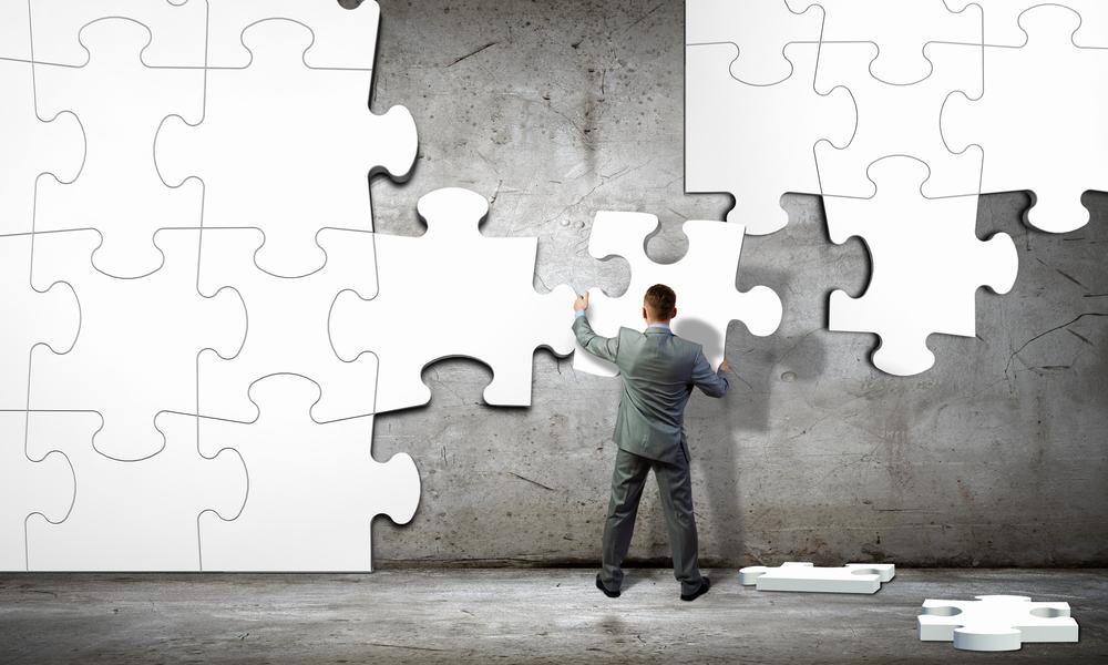 Image of businessman compiling macro white puzzle. Building business, comparison between MongoDB vs MySQL concept