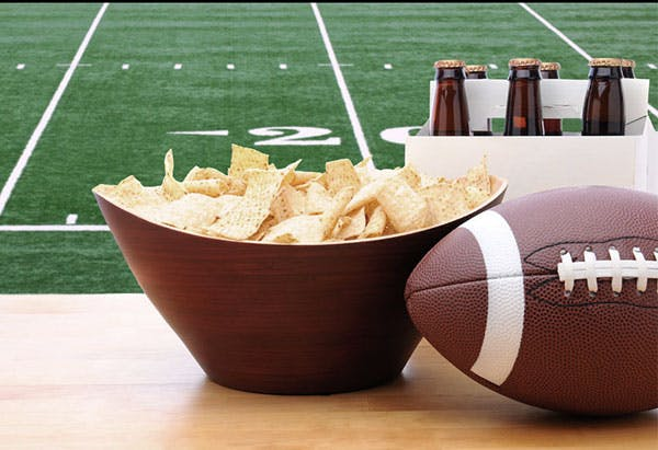 Close-up of chips, beers and the Super Bowl ball. Concept of preparation for the super bowl weekend