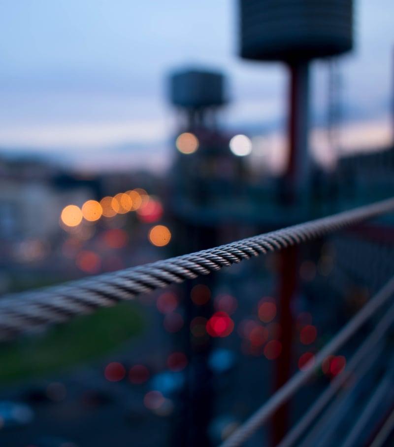 close-up image of a bridge at dusk