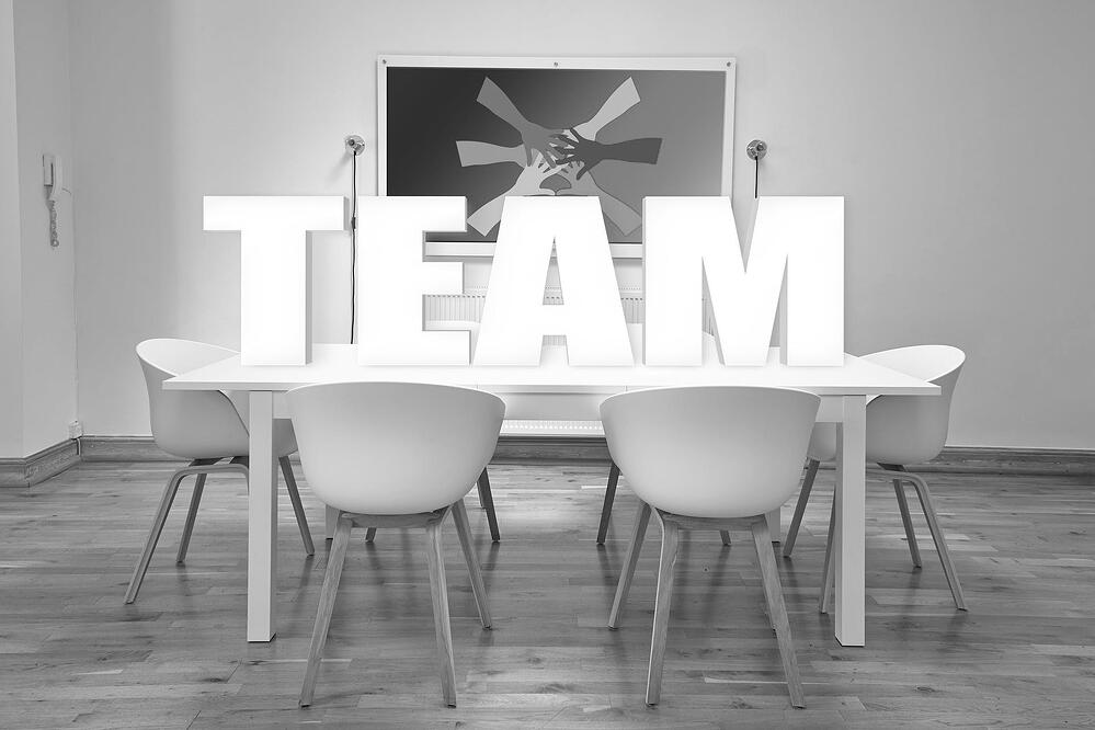 grayscale image of a conference room as a concept of a scrum team