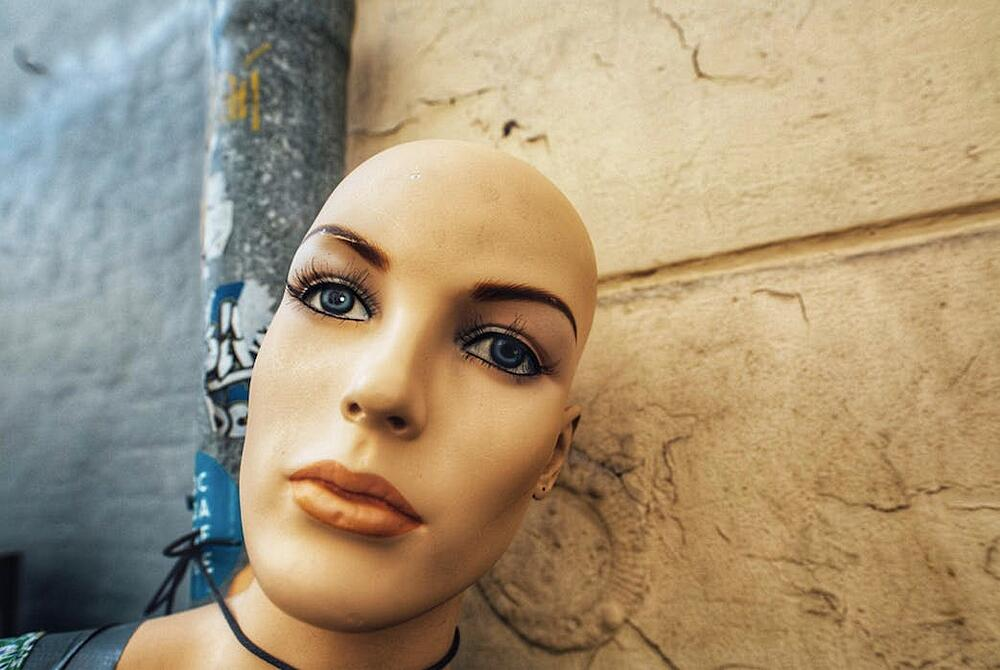 close-up of cyborg head with blue eyes