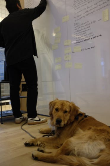 inside a design sprint - writing on a whiteboard