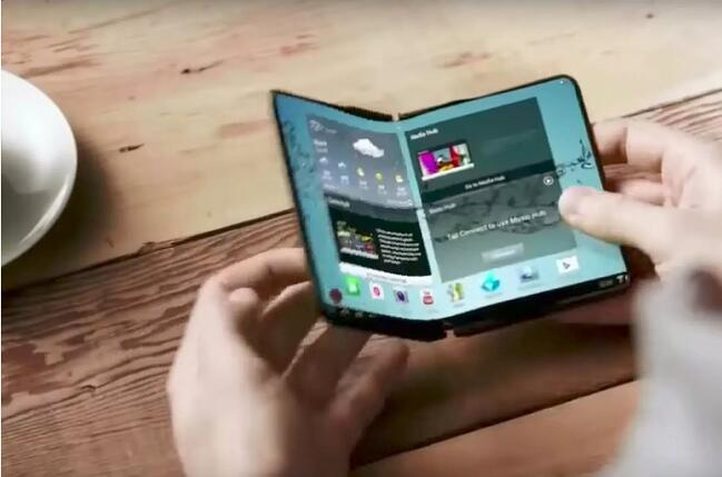 Close-up of a foldable phone over a a wooden table