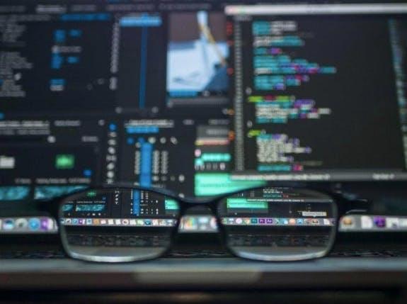 glasses on desk, as a concept of mysql vs ms sql server
