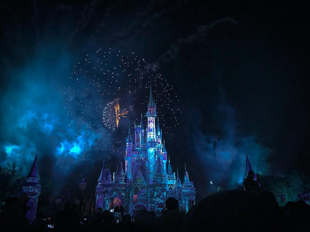 image of a Disney castle by night