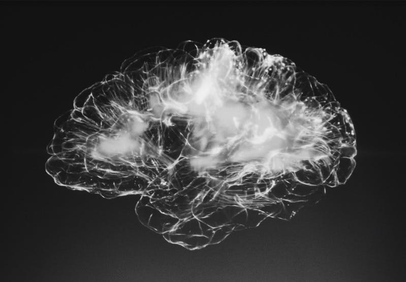 Ball of light in the shape of brains, on black, as concept of AI.