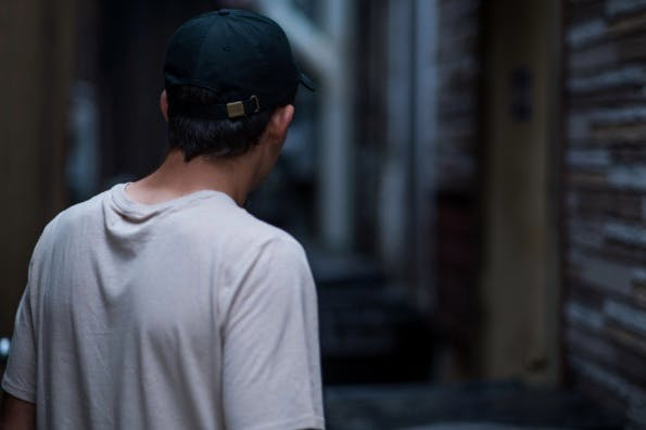 man with cap from behind