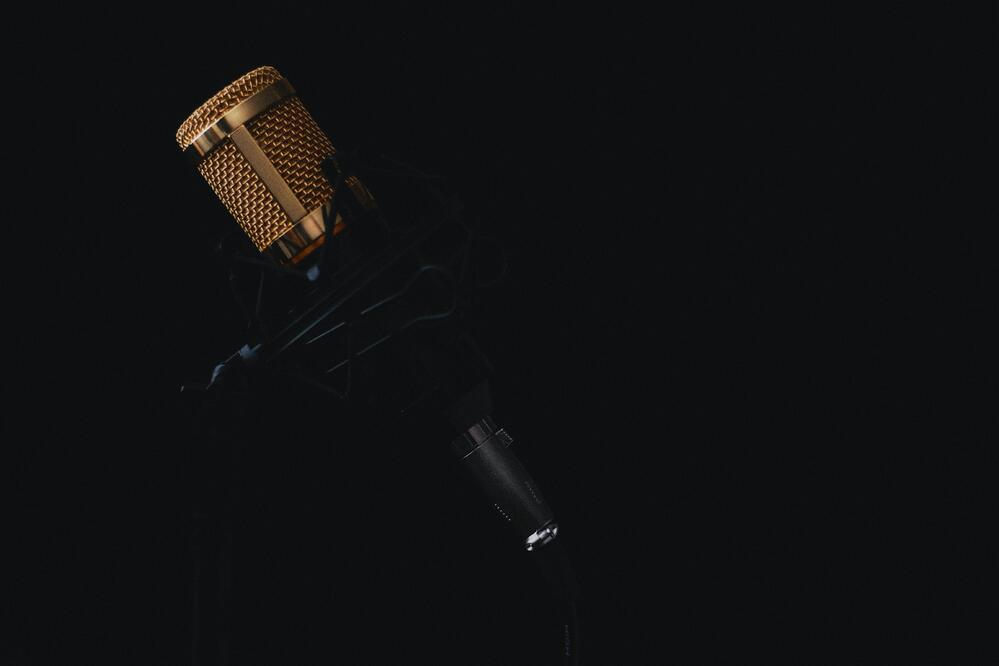 close-up image o microphone on black, as a concept of an innovative software