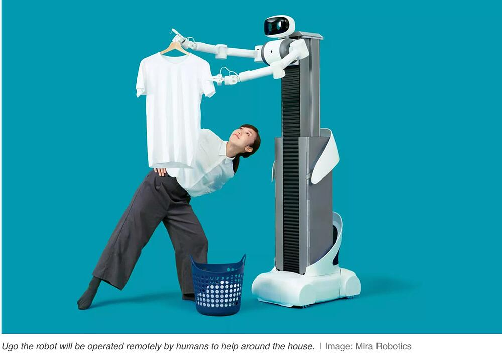 robot holding a tshirt and woman looking at it on blue background