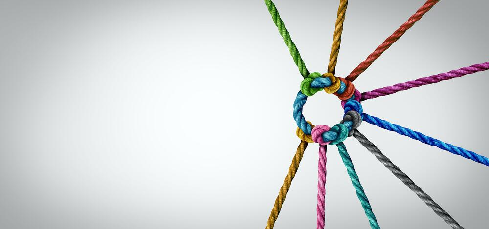 vectorial image of colorful ropes tied together, as a concept of partnership