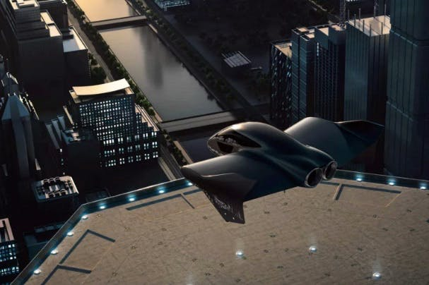 Computer graphics of a flying taxi hovering over the city buildings