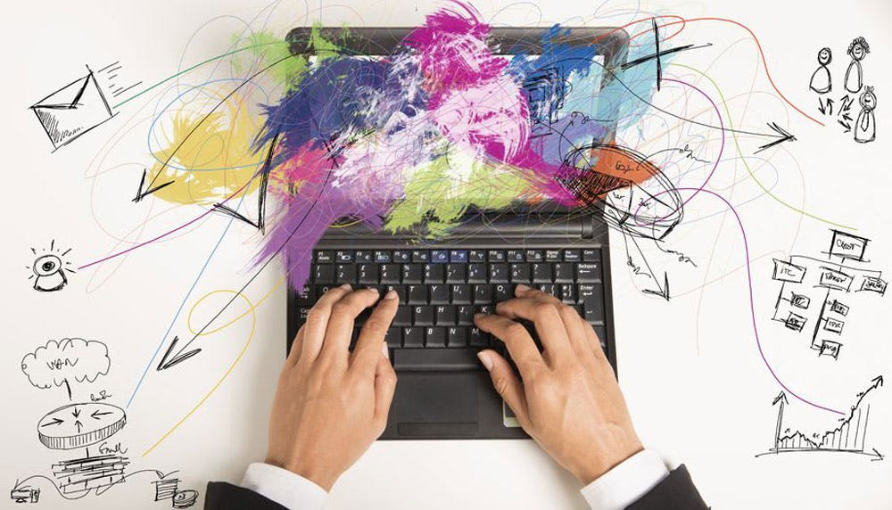 Typing on a keyboard, sketches and a splash of colors, as a concept of website as a sales person