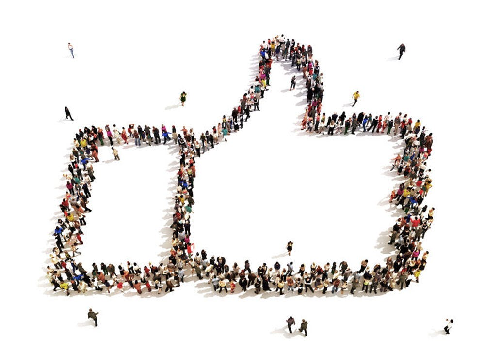 thumb up made of people on a white background