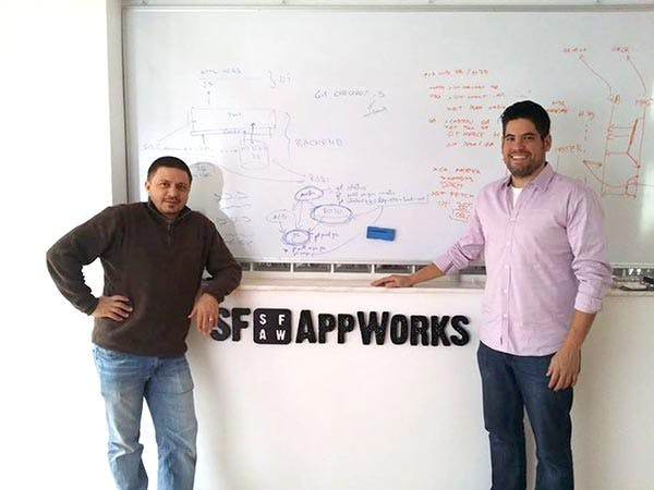 SF AppWorks' founders: Andrew Greenstein and Darius Zagrean with SF AppWorks logo on the wall behind them