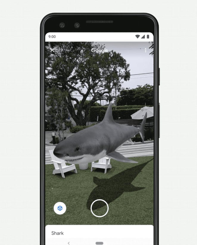 shark floating above grass on a iPhone screen