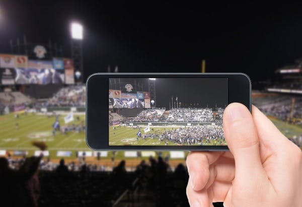 recording a Super Bowl game on a stadium with a smartphone