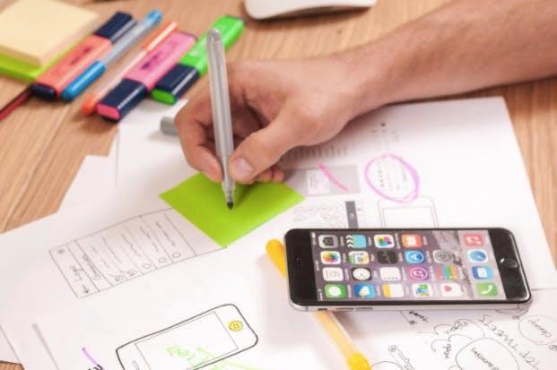 teking notes, drawing an app