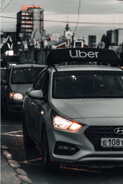 Uber uses a revenue share mobile app business model.
