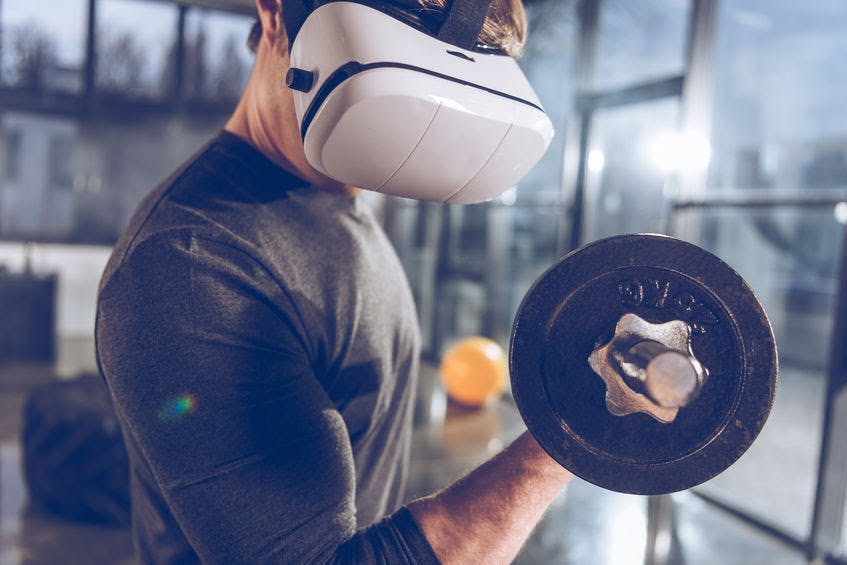 man at the gym with vr headset