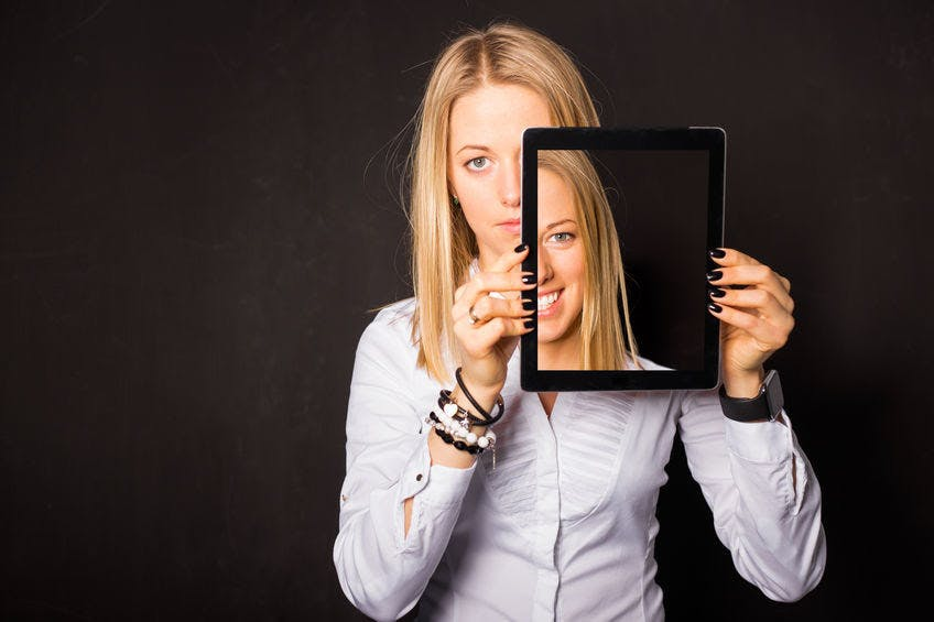 blonde girl with a black frame